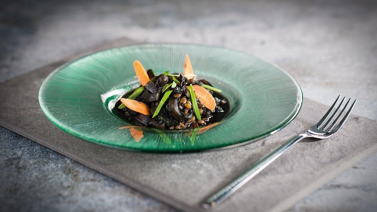 Lentejas negras con guiso de calamar
