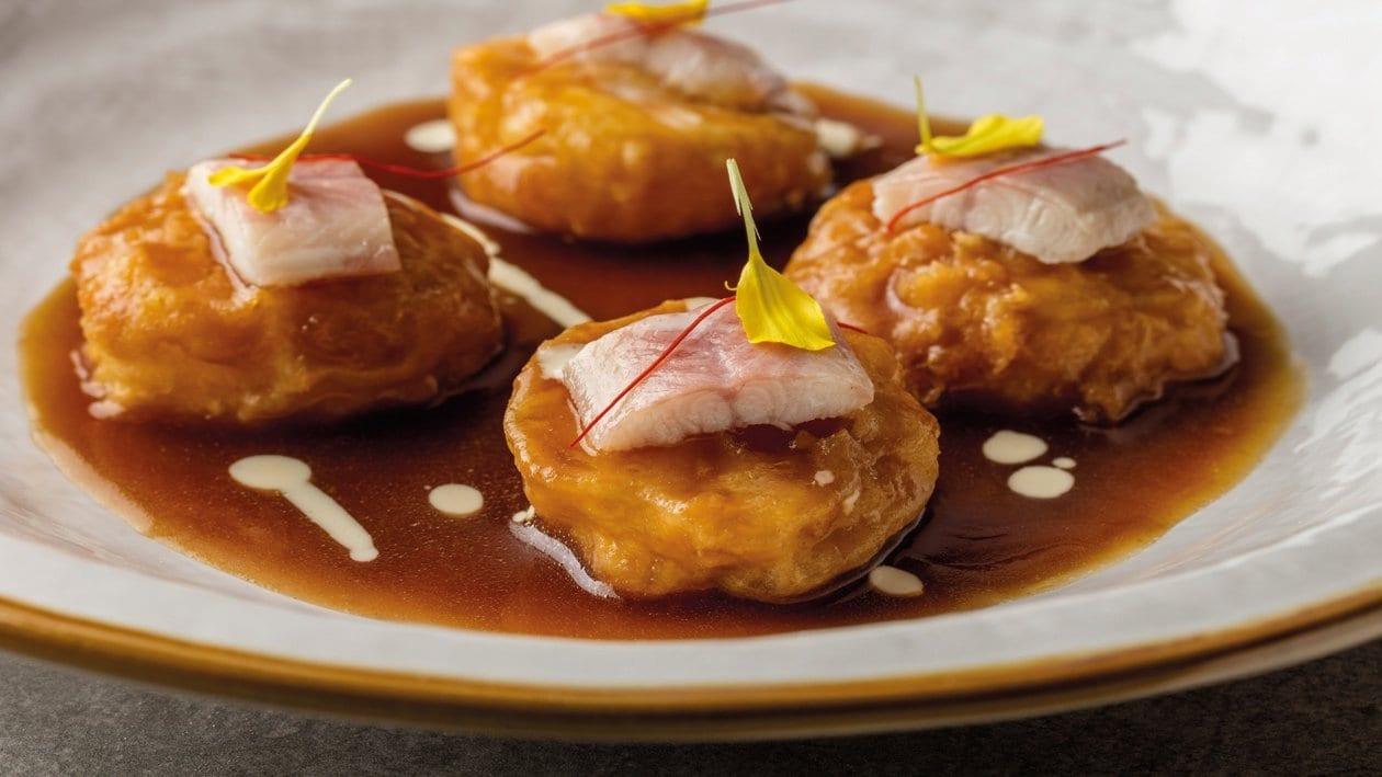Patatas a la importancia con anguila ahumada